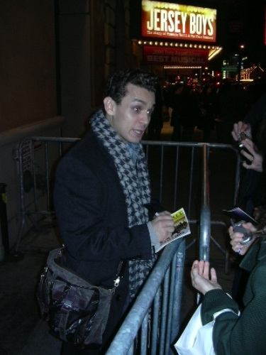 Michael Longoria signing autographs at the stage door.